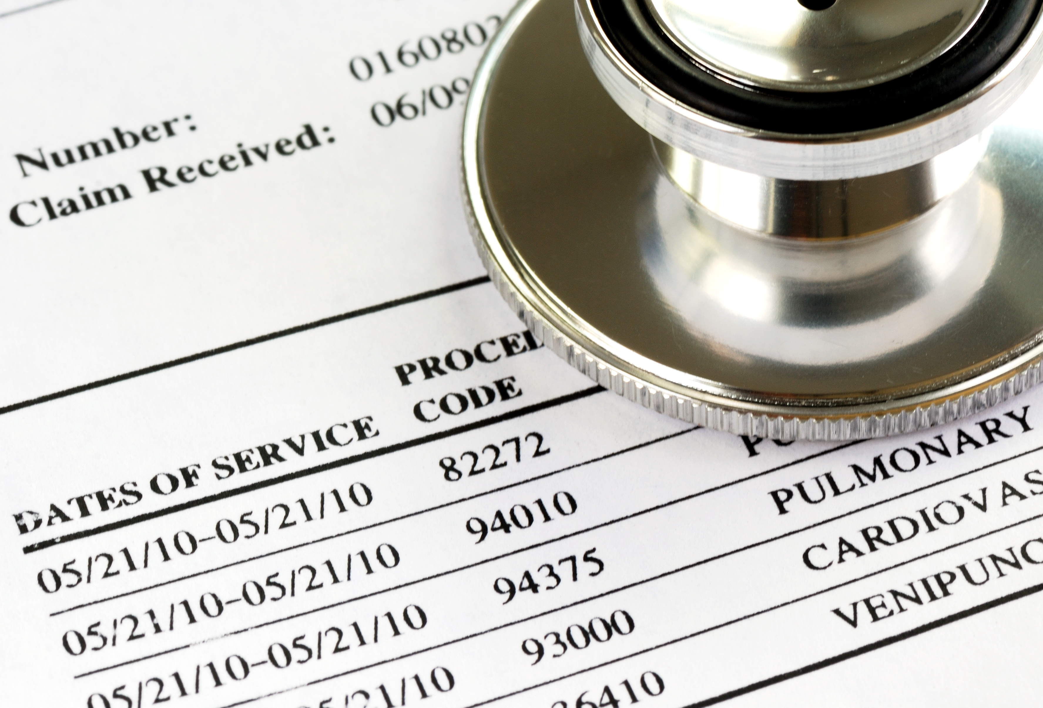Medical bill examined with a physician's stethoscope | healthcare news | primaris