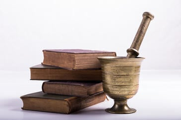Old medical books and old mortar and pestle | healthcare news | Primaris