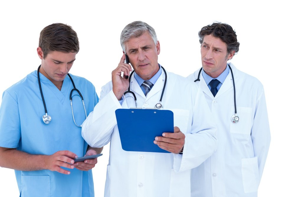 Doctors using technology, which can be distractions from building patient relationships.