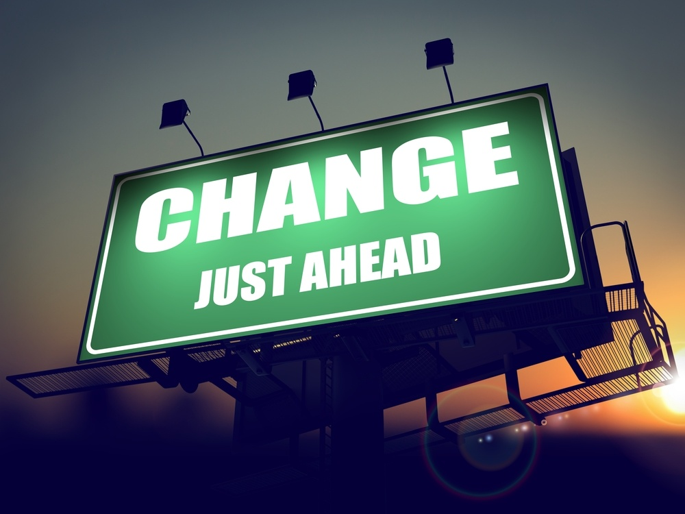 Change Just Ahead - Green Billboard on the Rising Sun Background.-1