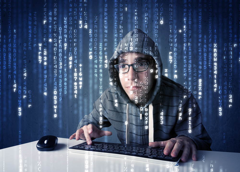 Hacker decoding information from futuristic network technology with white symbols-1