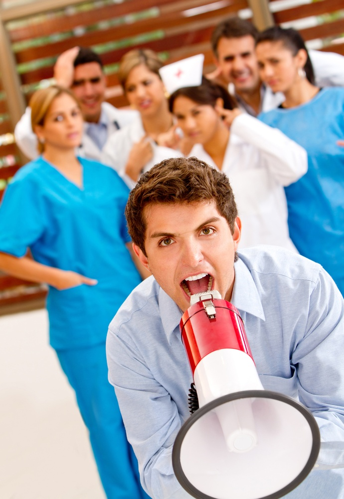 Patient at the hospital shouting on a megaphone to the doctors