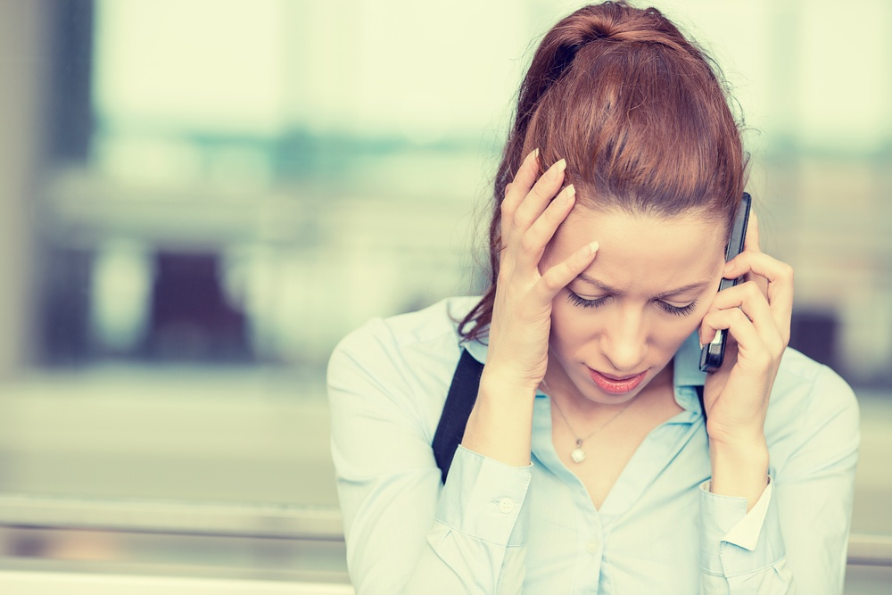 Portrait unhappy young woman talking on mobile phone looking down. Human face expression, emotion, bad news reaction