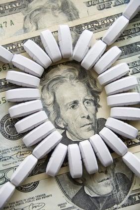 Ring of light-colored tablets on U.S. $20 bills-3