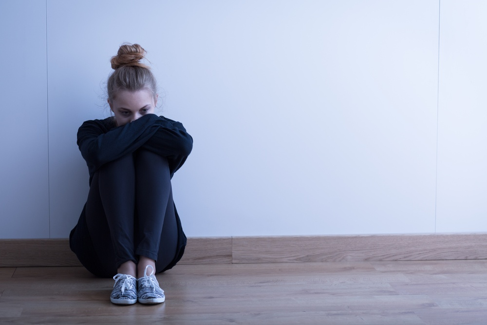 Sad woman with depression sitting on the floor.jpeg