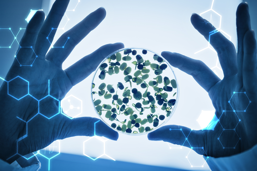 Science graphic against researcher hands holding sprouts in petri dish-1