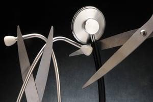 Scissors poised to snip stethoscope cord illustrates hospital budget cuts | healthcare news | Primaris
