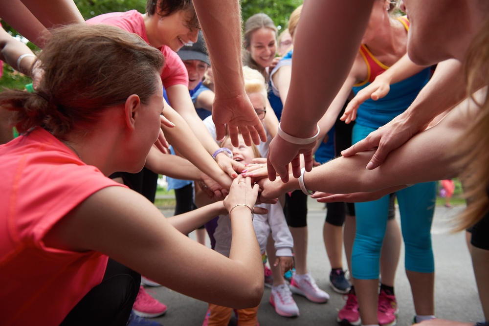 jogging people group, friends have fun,  hug and stack hands together after training.jpeg